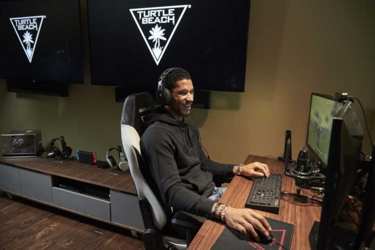 Josh Hart playing from his room with Turtle Beach gear.