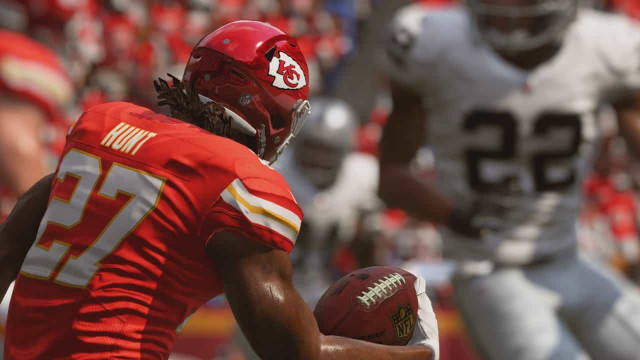An EA Madden NFL player running with the ball.